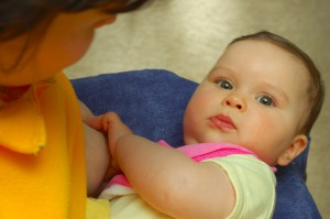 Baby Girl Distracted From Breastfeeding