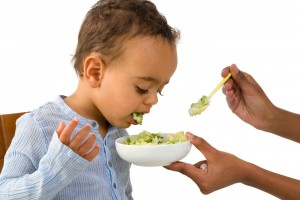 Little 18 month African toddler boy refusing to eat his vegetabl